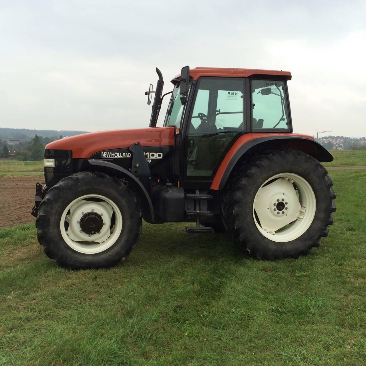traktor mit frontlader new holland m100. Black Bedroom Furniture Sets. Home Design Ideas